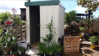 Fully installed shed with Lichen colour roof.
